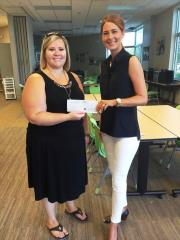 LuAnn Hansen presents a check to Ashley Winans, Boys and Girls Club of the Midlands in the amount of $1,250.00